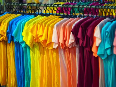 clothes rail: colorful t-shirt on sale  at funfair Stock Photo