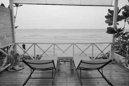 screened: black and white beach chair at seaside porch Stock Photo
