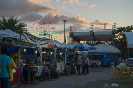 lunar month: food shop in  fair on urban of  Thailand such as Loy Kra Thong fair occurred 10 days in  twelfth lunar month, new year festival , anniversary established