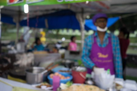 lunar month: merchant and food shop in  fair on urban of  Thailand such as Loy Kra Thong festival occurred 10 days in  twelfth lunar month, new year festival , anniversary established,blurred background
