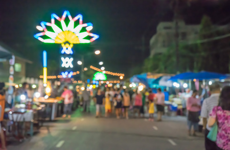 twelfth night: fair on urban of  Thailand such as Loy Kra Thong fair occurred 10 days in  twelfth lunar month, new year festival , anniversary established,blurred background Stock Photo
