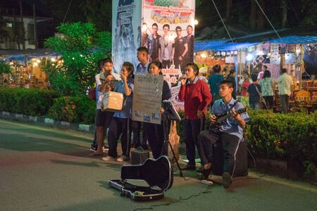twelfth night: student sing a song for donation in fair on urban of  Thailand such as Loy Kra Thong festival occurred ten days in  twelfth lunar month, new year festival , anniversary established Stock Photo