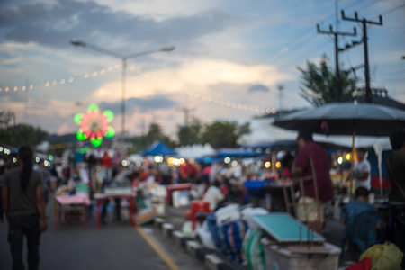 occurred: fair in urban of  Thailand such as Loy Kra Thong fair occurred ten days in  twelfth lunar month, new year festival , anniversary established,blur background