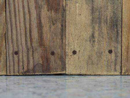 old wood floor: old wood, rust nail on terrazzo floor Stock Photo