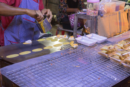 merchant: merchant making Thai pancake ,kind of Thai sweetmeat Stock Photo