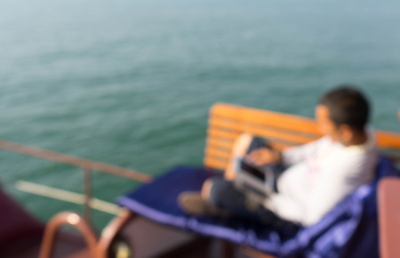 during: blur picture, man use smart phone during circumnavigate