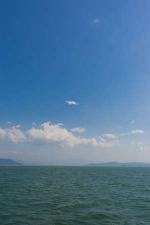 gently: blue sky , gently white cloud and ocean , vertical picture