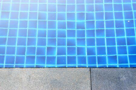 the edge: cement edge of swimming pool Stock Photo