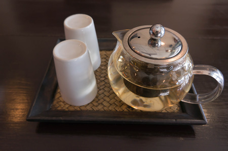 chinese tea pot: chinese tea pot and white ceramic glass on tea times at afternoon Stock Photo