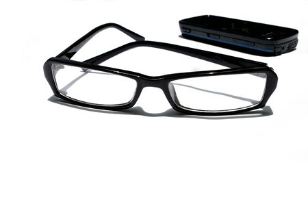 Clear eye glass and  telephone Stock Photo - 12408887