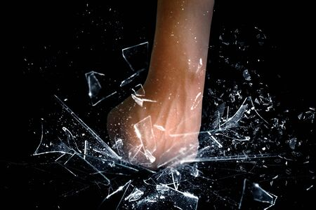 Hand punching the glass shattered Stock Photo - 18981575