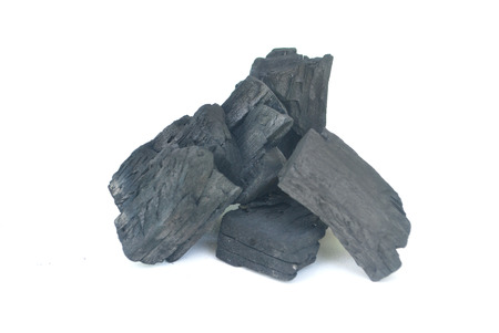 Charcoal burns through high-temperature combustion,Black wood charcoal white background,Charcoal White Background.