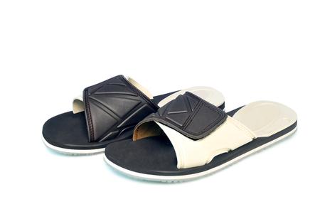 Dark brown sandals on white background.With Clipping Path. Reklamní fotografie