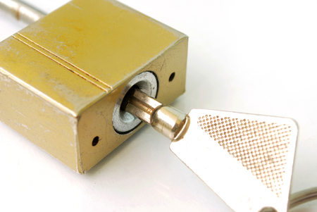 The old house lock key has no quality on white background.