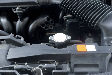 Car radiator system Maintenance of opening the radiator cap Car cooling system.