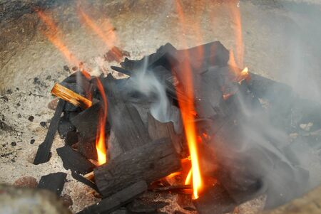 Ancient fire by using charcoal from wood. Stock fotó