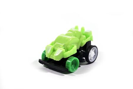 The green toy car is a collection put on a white background.