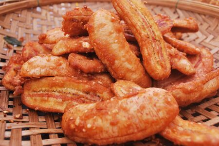 Thai style banana fries sprinkled with nuts and pandan aroma.