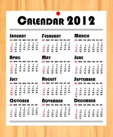 new year 2012 calendar on wooden board photo