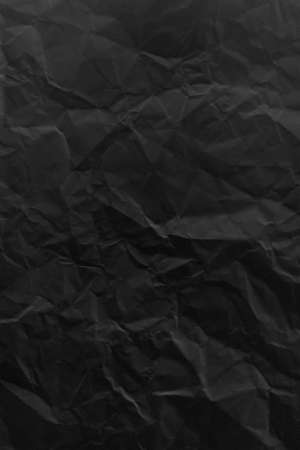 black crumpled paper background