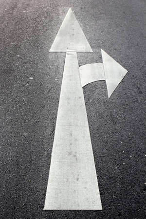 The arrow direction painted on road photo