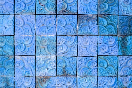 The blue square brick wall background photo