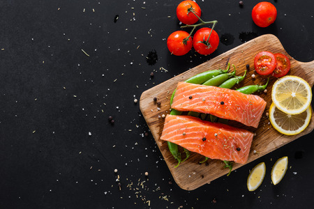 diet healthy food concept, raw fresh salmon fillet and ingredients on wooden background, top view