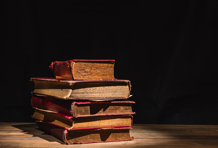 pile of old books on wooden table Stock Photo