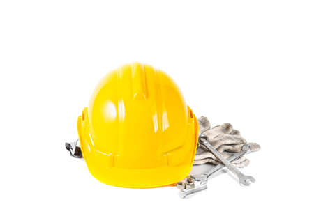yellow safety helmet and tools isolated on white background