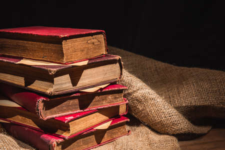 close-up of pile of old books on sackcloth