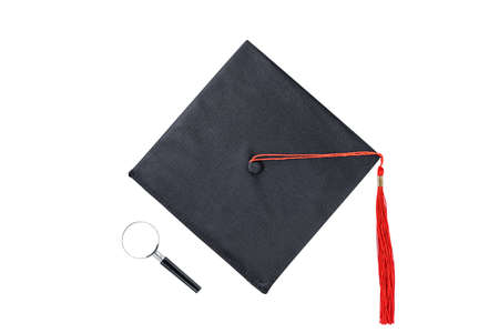 mortarboard and magnifying glass isolated on white background Reklamní fotografie