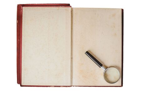 magnifying glass on opened old book blank isolated on white background