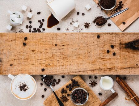 grunge wooden plank decorated with coffee and equipment, coffee background concept with copy space for text
