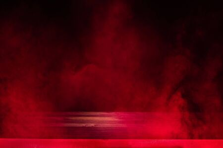 empty wooden table with red smoke float up on dark background Reklamní fotografie