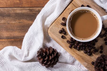 A cup of coffee and beans on wooden cutting board Reklamní fotografie