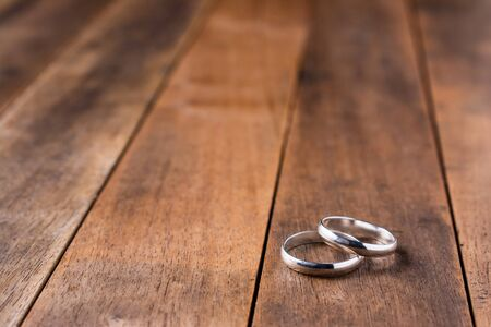 close-up of couple silver ring on wooden table Reklamní fotografie