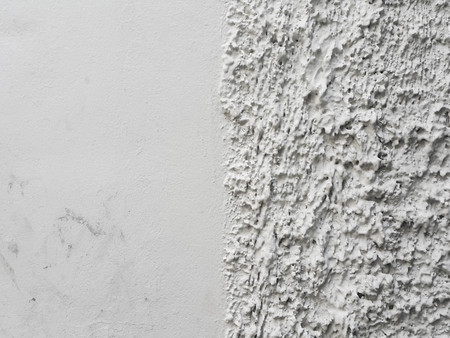 Half smooth and half rust concrete wall.