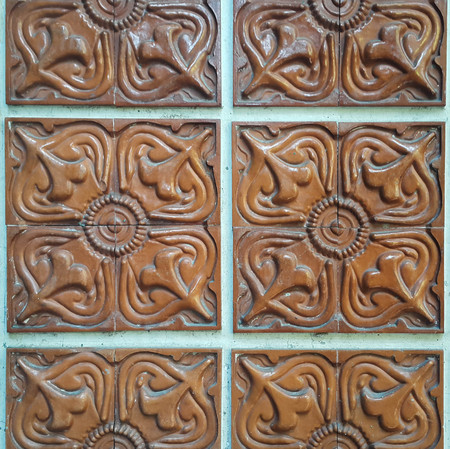 Brown Islamic pattern tiles which was discovered from a house in Islamic community.
