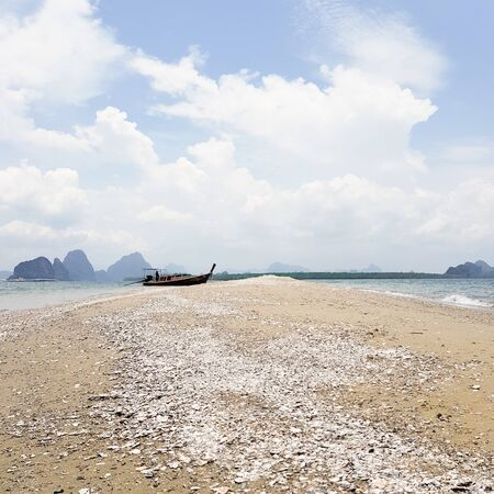 A lonely boat on an Island beach.