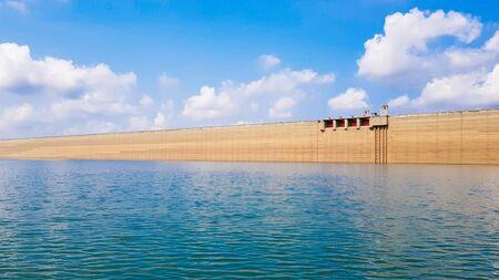 The longest concrete dam with a beautiful sky.