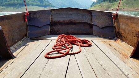 The red robe on the wooden boat.
