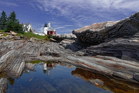 Pemiquid Point Lighthouse with a Blue Sky, Reflection of the Lighthouse into the tidal pool  photo