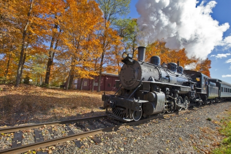 railway history: Steam Engine with Fall Foliage Background Horizontal Oreintation Stock Photo