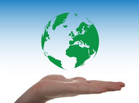 levitacion: Concepto sobre el medio ambiente a trav�s de un globo en la levitaci�n de una mano Foto de archivo