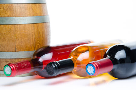 Bottles of wine with a cask, isolated on white photo