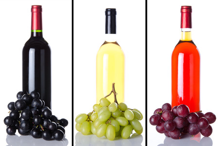 Collage of wine bottles and grapes, isolated on white photo