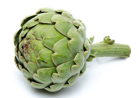 Beautiful fresh artichoke, isolated on white photo