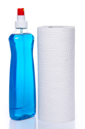 Cleaning spray with a roll of paper towels, isolated on white