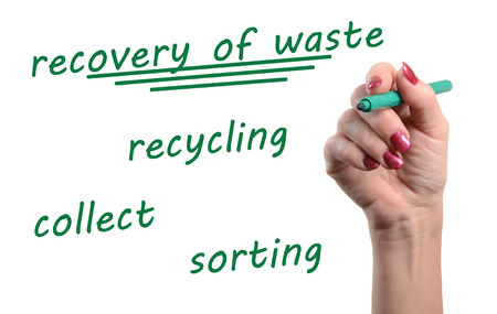 waste recovery: Concept of recovery of waste written with a green felt pen, isolated on white Stock Photo