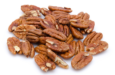 Heap of pecan nuts, isolated on white Stok Fotoğraf